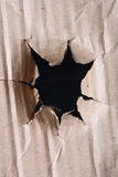 Hole in brown paper Royalty Free Stock Photo