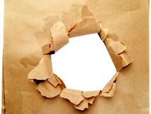 Hole in brown paper stock image