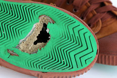 Hole on canvas shoes Stock Photo