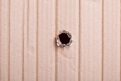 Hole in the cardboard Royalty Free Stock Image
