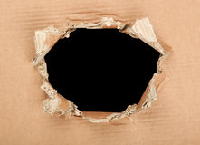 Hole in cardboard Royalty Free Stock Photo