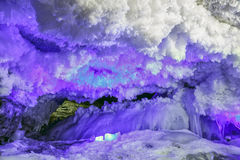 Hole in cave covered with colorful and futuristic ice structure. Hole in the cave covered with colorful and futuristic ice structure Royalty Free Stock Photo