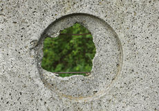 Hole in a cement fence Royalty Free Stock Photography
