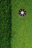 In the hole. Close up of a golf ball in the hole Royalty Free Stock Photography