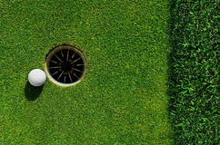 In the hole. Close up of a golf ball in the hole Stock Photography