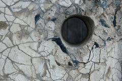Hole in a concrete fence. Stock Images