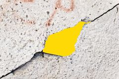 Hole in the concrete gray wall Stock Images