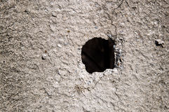 Hole in concrete wall Stock Photo
