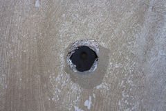 A hole in a concrete wall Stock Photo