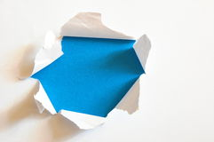 Hole with copyspace. Blue hole with copyspace in blank and empty sheet paper Royalty Free Stock Image