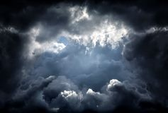 Hole in the Dramatic Clouds. Hole in the Dark and Dramatic Storm Clouds Royalty Free Stock Photo