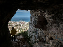 Hole of Denia with tourist from water cave Royalty Free Stock Photography