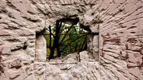 Hole in the destruction concrete wall, bullet hole, abstract background free space for design after war stock image