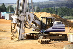 Hole Digger. Large hole digger on a construction site Royalty Free Stock Images
