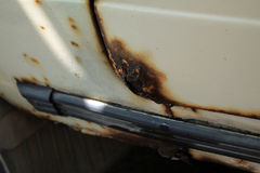 Hole in door and threshold of old car, damaged by rust and corro Stock Photography