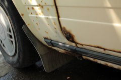 Hole in door and threshold of old car, damaged by rust and corro Royalty Free Stock Photo