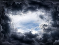 Hole in the Dramatic Clouds. Hole of the Sky in the Dark Storm Clouds Royalty Free Stock Photography