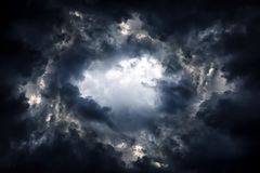 Hole in the Dramatic Clouds. Tunnel in the Dark and Dramatic Clouds royalty free stock photo
