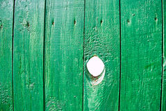 Hole in a fence Stock Photo