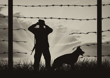 Hole in fence on border and border guards with dog Royalty Free Stock Photos