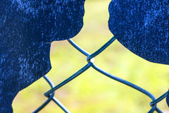 Hole in a fence Royalty Free Stock Photo