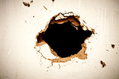 Hole in the fibreboard Stock Images