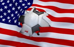 The hole in the flag of USA and soccer ball Royalty Free Stock Photography