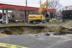 Hole at gas station renovation. Cherry Hill, New Jersey - December 13, 2018: A large hole is seen in the ground where an old gas storage tank has been removed at royalty free stock image