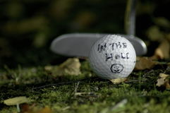 Golf. In the hole.. Sometimes golfers use subtle pieces of sports psychology to help with their putting skills Stock Photos