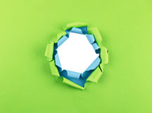 Hole in green and blue paper Royalty Free Stock Photo