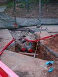 Hole in the ground. A hole being dug in the ground for utilities Stock Photo