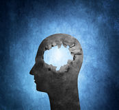 Hole in the Head. Conceptual image of a cardboard head with a hole Stock Image