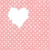 Hole in heart shape on Polka dot background Royalty Free Stock Images
