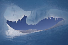 Hole in an iceberg with a view of the Antarctic sky stock image