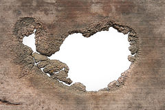 A hole with jagged decaying edges Stock Photos