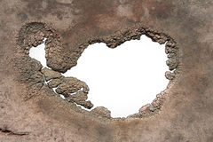 A hole with jagged decaying edges Royalty Free Stock Image