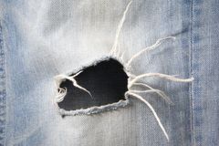 Hole in jeans Stock Photos