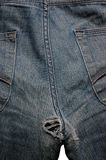 Hole in jeans Royalty Free Stock Images