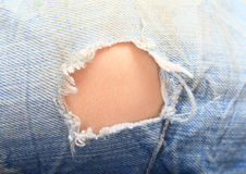 Hole in jeans Royalty Free Stock Image