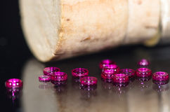 Hole Jewels Gathered Beside a Corked Vial Stock Photography