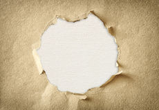 Hole made of torn paper over textured canvas background Stock Photos