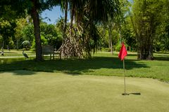 Hole marked with red flag at the mini golf area. At Maldives Royalty Free Stock Images