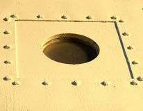 Hole in metal with rivets Royalty Free Stock Photo