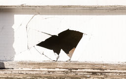 Hole with multiple cracks in a white wooden panel Stock Photos