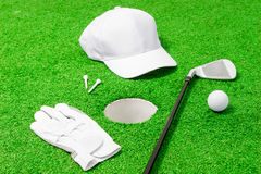 Hole and objects for the game of golf Stock Photo