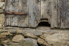 Hole in old barn door Stock Photos