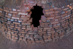 Hole in the old brick stove. Black hole in the old red brick stove in the rural area of Thailand Stock Images