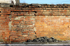 A hole in an old crooked brick wall is brickied. Stock Photo