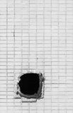 Hole on the old white wall Stock Images