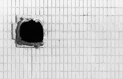 Hole on the old white wall Stock Photos